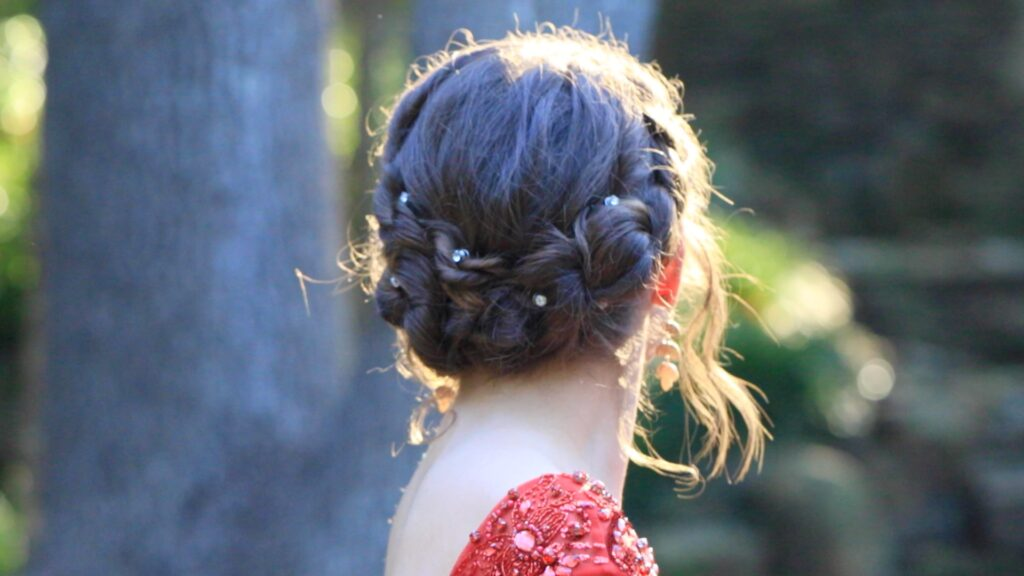 Young girl outside modeling Rope Twist Updo | Homecoming Hairstyles