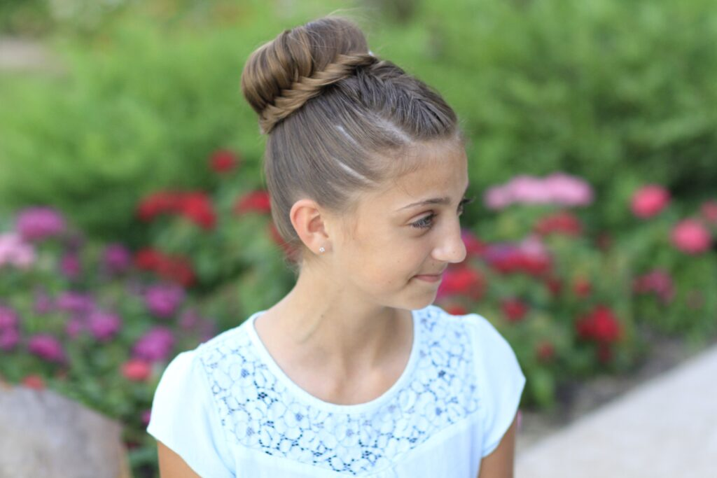 young girl outside modeling Lace Fishtail Bun