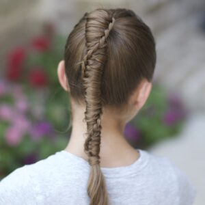 Young girl outside modeling Chinese Staircase Braid (back)