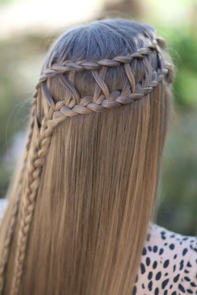 Young girl outside modeling Lattice Braid Combo (back)