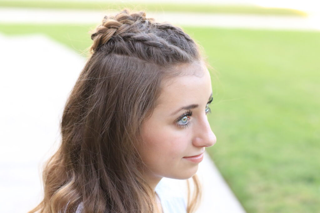 Profile of young girl modeling Half-Up Rosette Combo | Homecoming Hairstyles