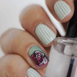 mint and white striped mani with rose accent