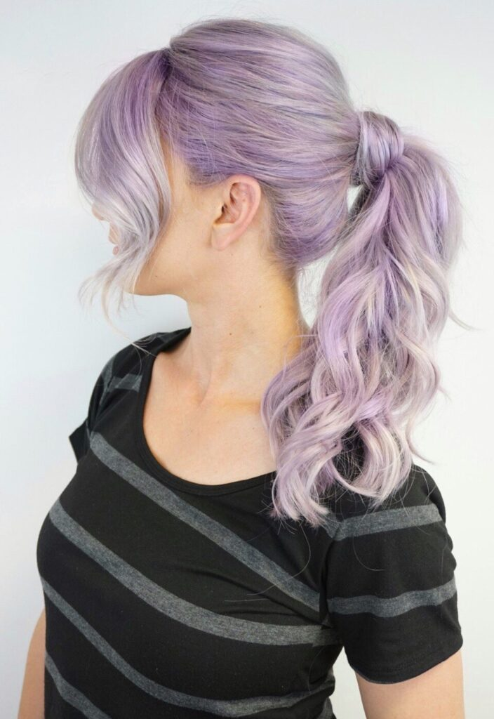 Profile Side view of girl with lavender modeling a high ponytail in front of a white background