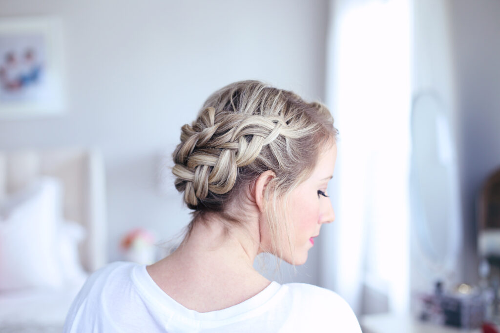 "Profile side view of young women standing in her room modeling ""Crown Braid"" hairstyle"
