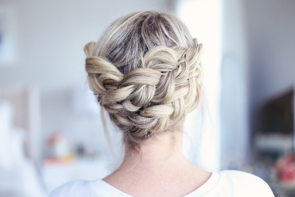 "Close up view of young women standing in her room modeling ""Crown Braid"" hairstyle"