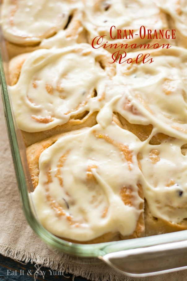 Cran-Orange Cinnamon Rolls topped with white frosting in a serving platter | CGH Lifestyle