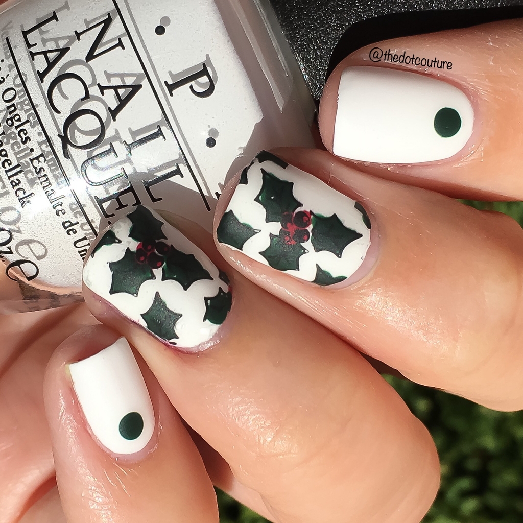 White painted nails with green poinsettia nail art