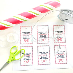 "Assorted craft laying on a white background with printable ""Hope you are getting wrapped up in the spirit of the season"" tags"