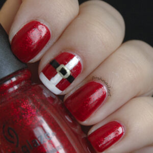 "Red painted nails inspired by ""Santa"" holding a red bottle of nail polish"