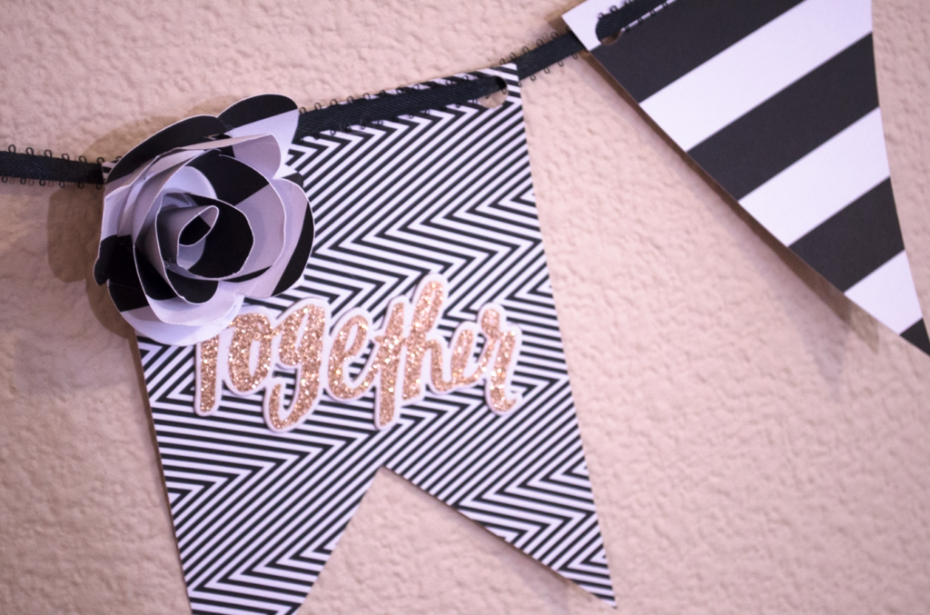 "Black and white DIY banner with gold ""Together"" sticker and large paper flower"