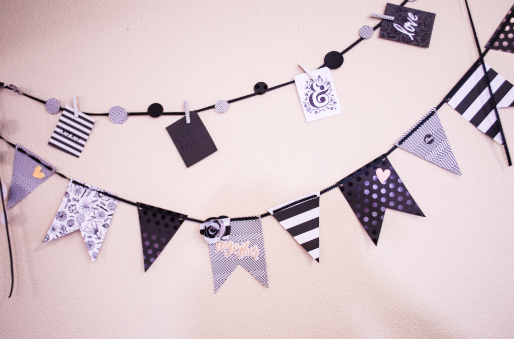 Cute black and white paper banner hanging on a white wall