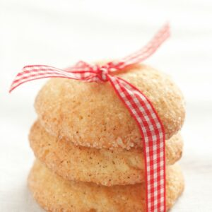 Three stacked snickerdoodle cookies and tied with a picnic pattern ribbon