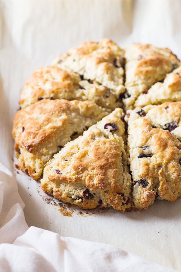 Cherry and Chocolate Scones cut into 8 slices, placed on a white background