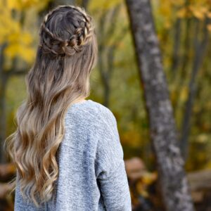"Back view of young woman outside wearing gray shirt, modeling ""Dutch Halo Braid"" hairstyle"