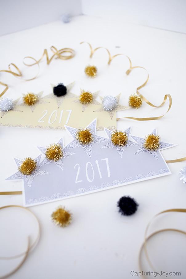Two '2017' signs surrounded by an assortment of crafts in gold, silver, and black colors