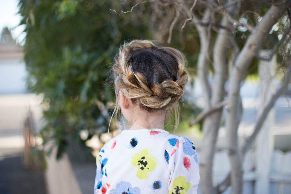 "Back view of young girl outside modeling ""Pull-Thru Crown Braid"" hairstyle"