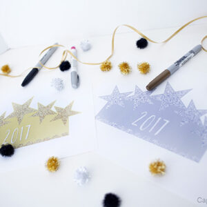 An assortment of crafts and markers in gold, silver, and black colors