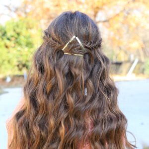 """Back view of a young girl outside with long hair modeling """"Barrette Tieback"""" hairstyle"""