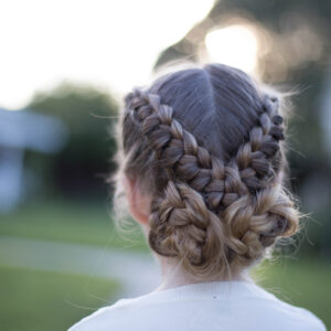 "Back view of a young girl standing outside modeling ""Flip Over Braid"" hairstyle"