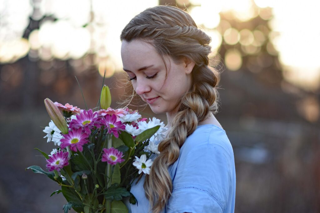 Profile view of a young girls holding flower bouquet