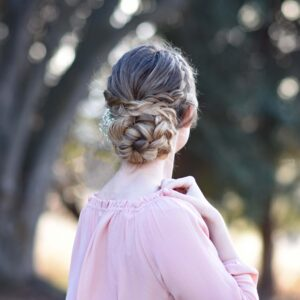 "Back view of girl wearing a pink shirt standing outside modeling ""Dutch Braided Updo"" hairstyle"