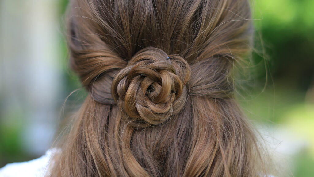 "Close up of ""Rosette Tieback"" hairstyle"
