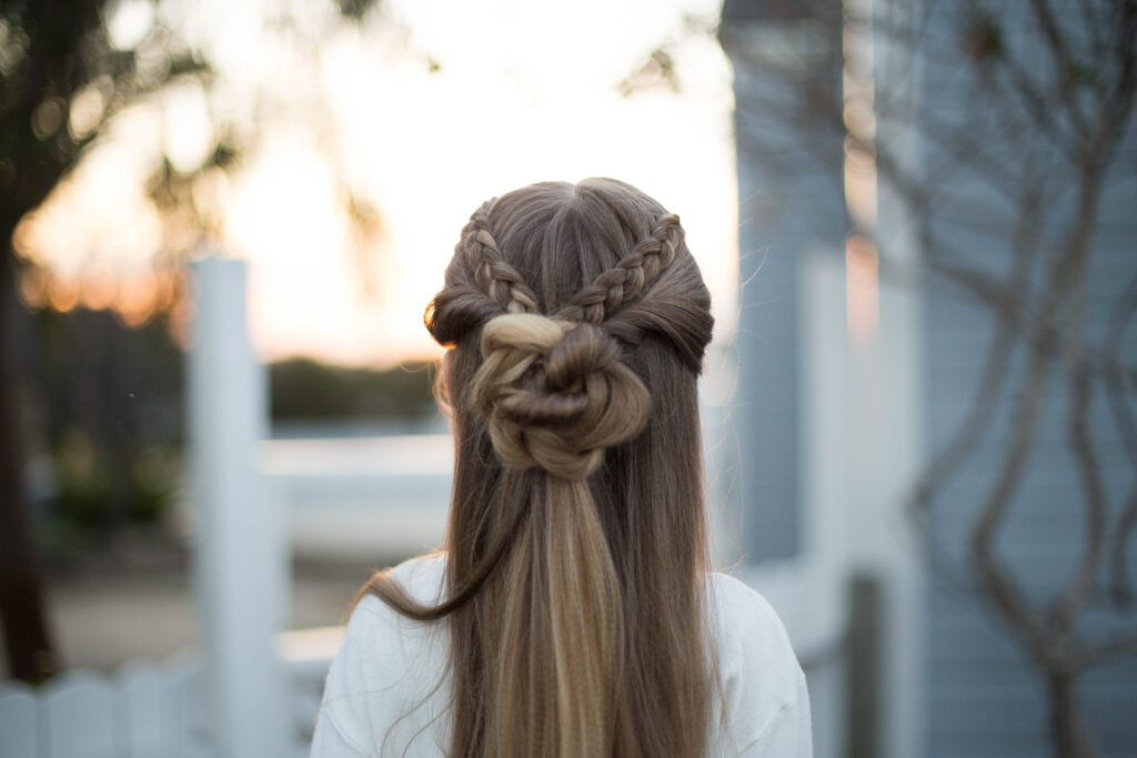 "Close up back view of a young girl outside modeling cute ""Braided Bun Combo"" hairstyle"