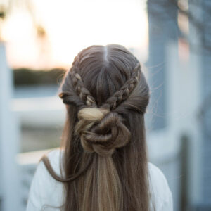 "Profile for a young girl outside modeling cute ""Braided Bun Combo"" hairstyle"