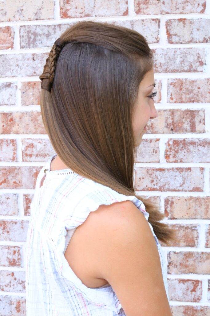 "Side view of young girll with long hair modeling ""Reverse Chinese Ladder"" hairstyle"