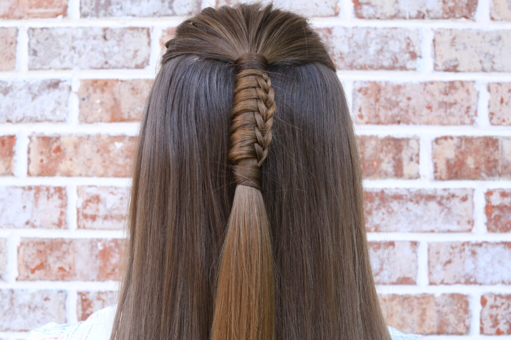 """Back view of girl with long hair modeling """"Reverse Chinese Ladder"""" hairstyle"""