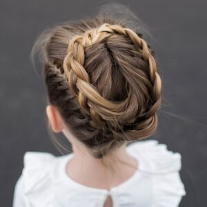 "Top view of a little girl wearing a white shirt modeling ""Halo Braid"" hairstyle"