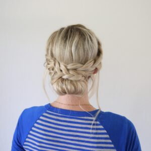 "Back view of woman standing in front of a white background with a blue shirt modeling ""French Lace Updo"" hairstyle"
