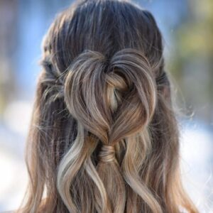 "Close up of ""Half Up Heart Bun"" hairstyle"