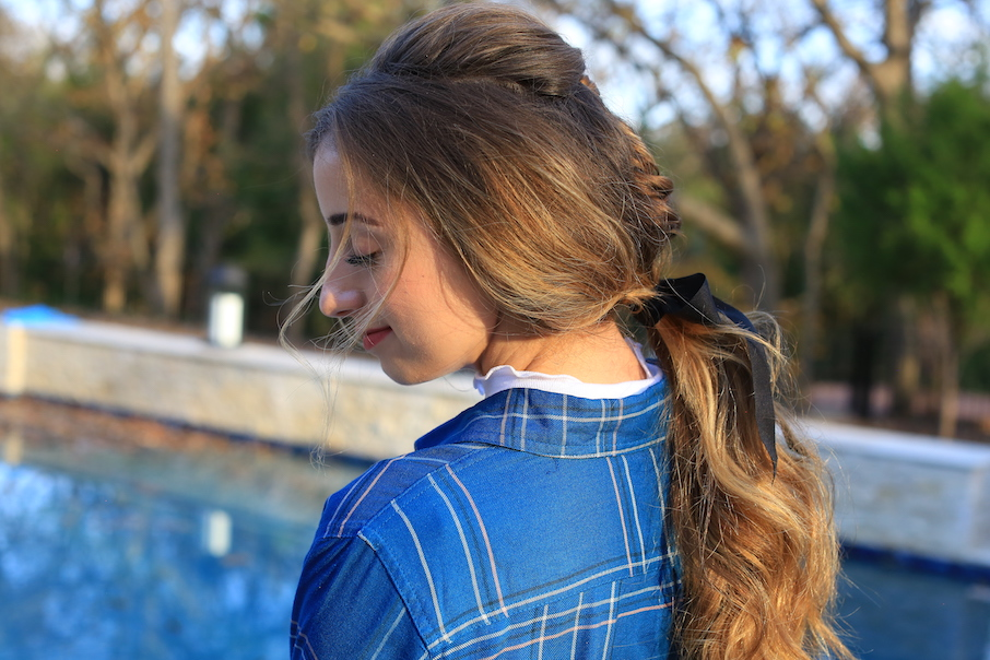 "Side view of girl standing outside wearing a blue shirt modeling ""Fishtail Ponytail"" hairstyle"