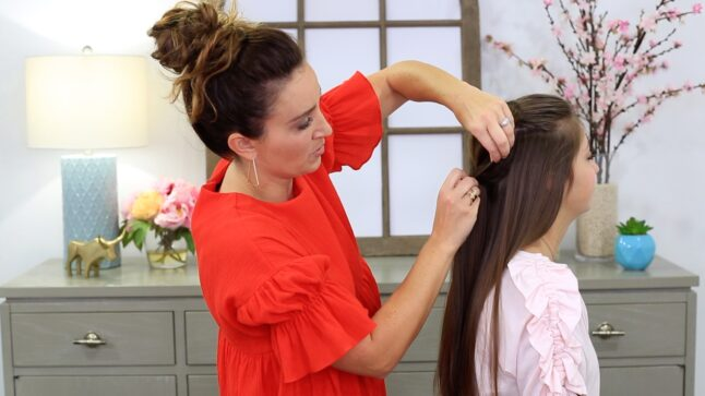 Mother styling her daughter's hair