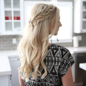 "Side view of a blonde woman standing her kitchen modeling ""Half Up Side Braid"" hairstyle"