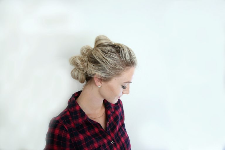 """Young blonde women standing in front of white background modeling """"Bubble updo"""" hairstyle"""""""