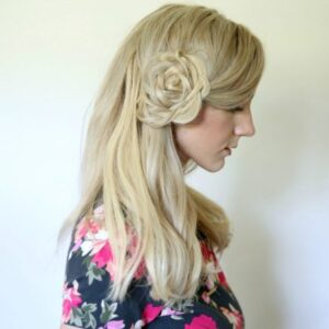 "Profile of young blonde woman wearing a floral shirt modeling ""Flower Braid Bun"" hairstyle"