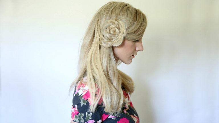 """Profile of young blonde woman wearing a floral shirt modeling """"Flower Braid Bun"""" hairstyle"""