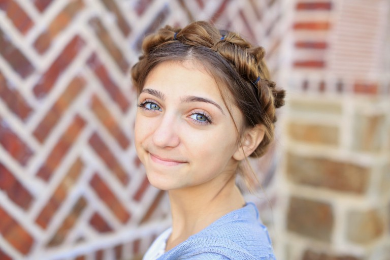 """Portrait of girl smiling standing outside modeling """"Faux Crown Braid"""" hairstyle"""