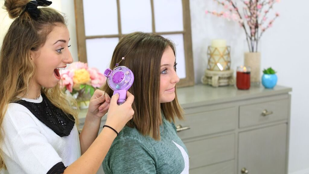 Two sisters using products to style each other's hair.
