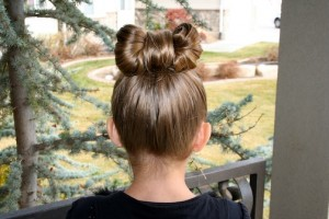 "Back view of young girl standing outside modeling ""Lady Gaga Hair Bow"" hairstyle"
