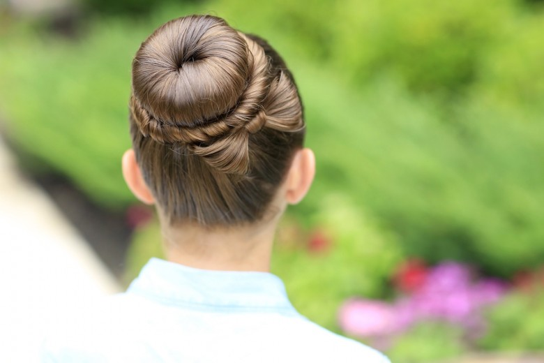 "Back view of girl standing outside modeling ""The Perfect Bun Updo"" hairstyle"