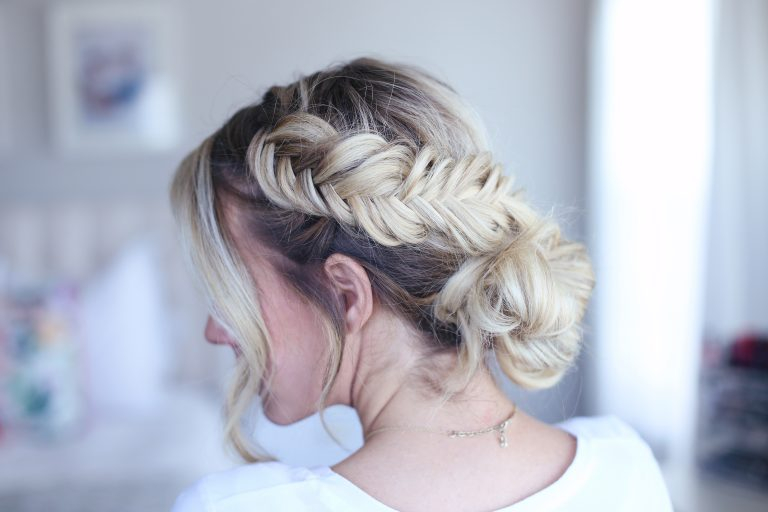 "Side view of young woman standing in her room wearing a white shirt modeling ""Fancy Fishtail Updo"" hairstyle"