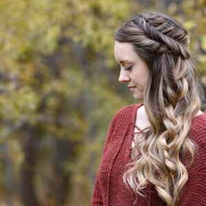 """Back view of girl with red shirt standing outside modeling """"Side Swept Fishtail"""" hairstyle"""