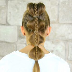 "Back view of girl with white shirt standing outside modeling ""Stacked Bubble Braid"" hairstyle"