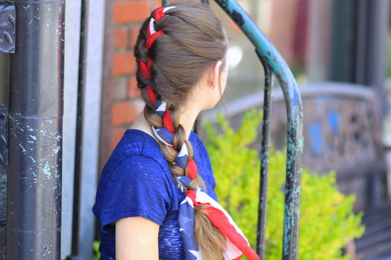 "Side view of girl sitting outside in a blue shirt modeling ""Quick Scarf Braid"" hairstyle"