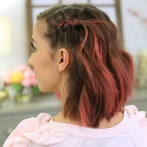 "Side view with pink dyed hair indoors to modeling ""Side Pull Back"" hairstyle."