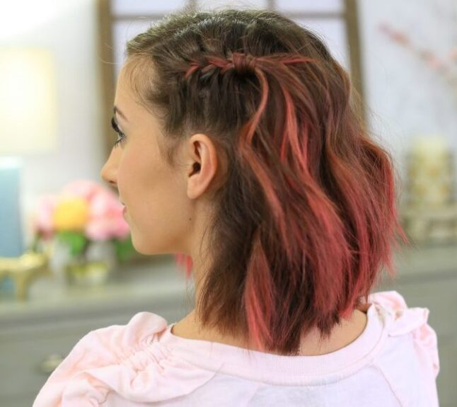 """Side view with pink dyed hair indoors to modeling """"Side Pull Back"""" hairstyle."""