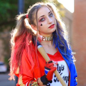Girl standing outside posing and wearing 'Harley' Halloween costume.